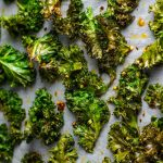 These are the best kale chips you will ever have! The chili flakes and garlic give them a nice kick you will keep coming back for.
