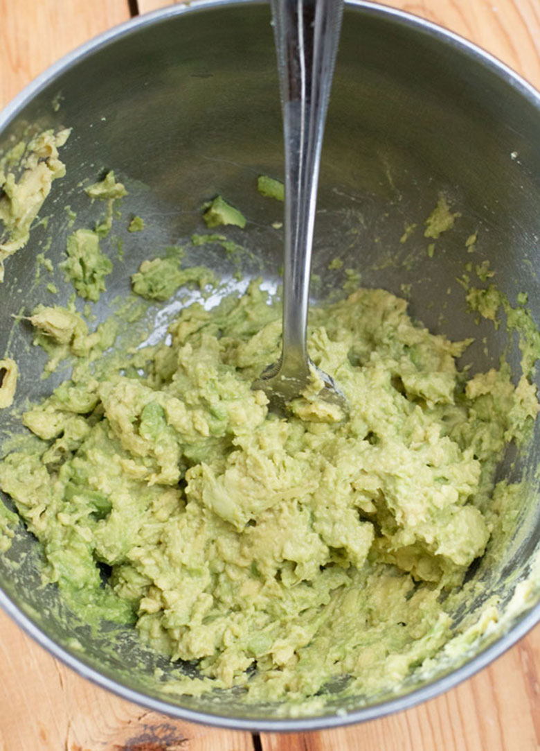 mixing the guacamole