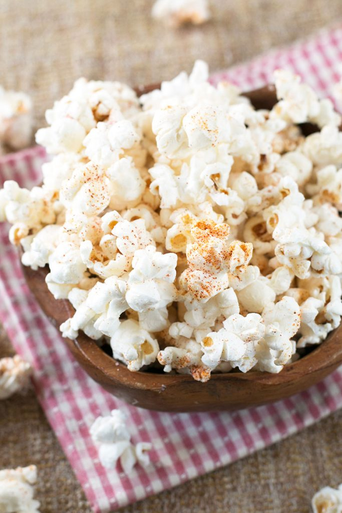 Try this super healthy coconut oil popcorn recipe! You will love it.